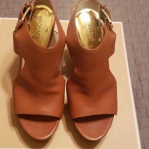 Michael Kors tan leather wedge high heels.